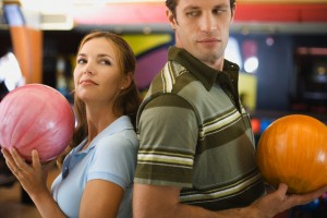 Back to back couple with bowling balls