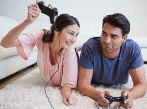 Woman beating her fiance while playing video games