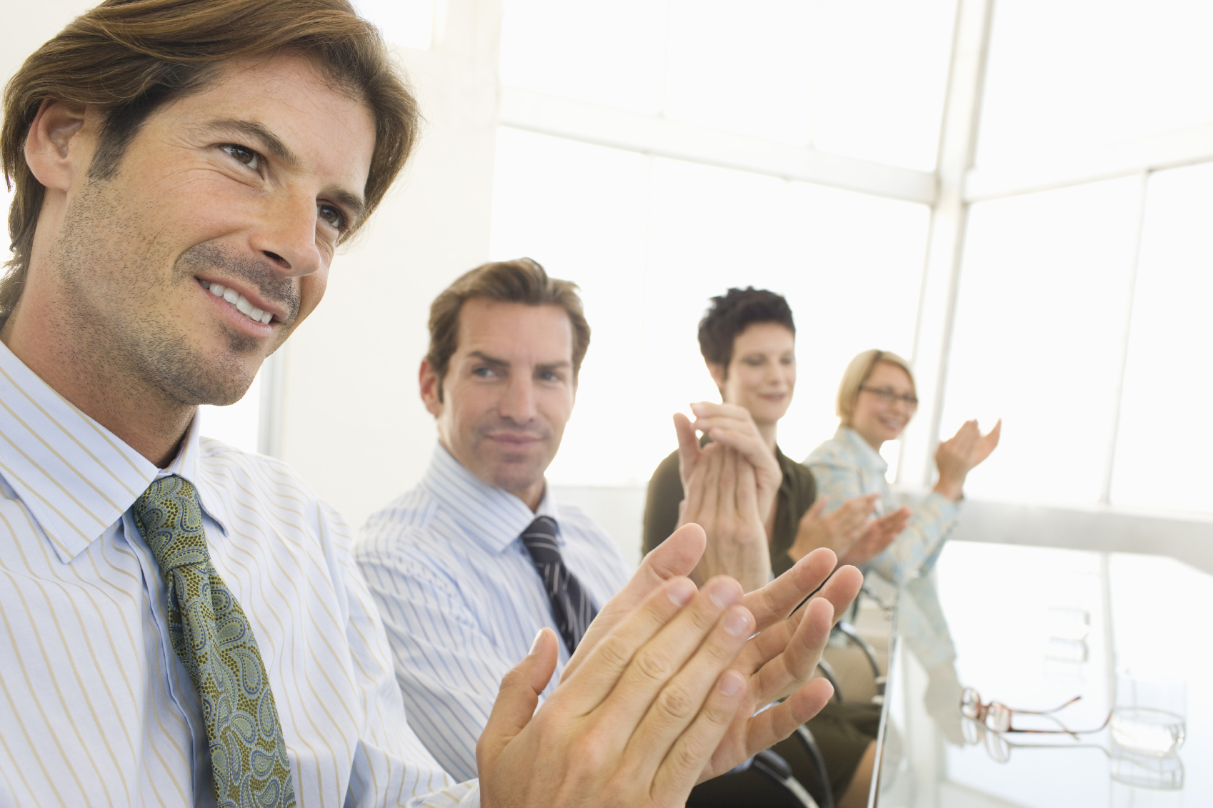 Business Colleagues Applauding In Conference Room