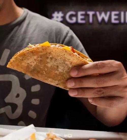 man holding taco